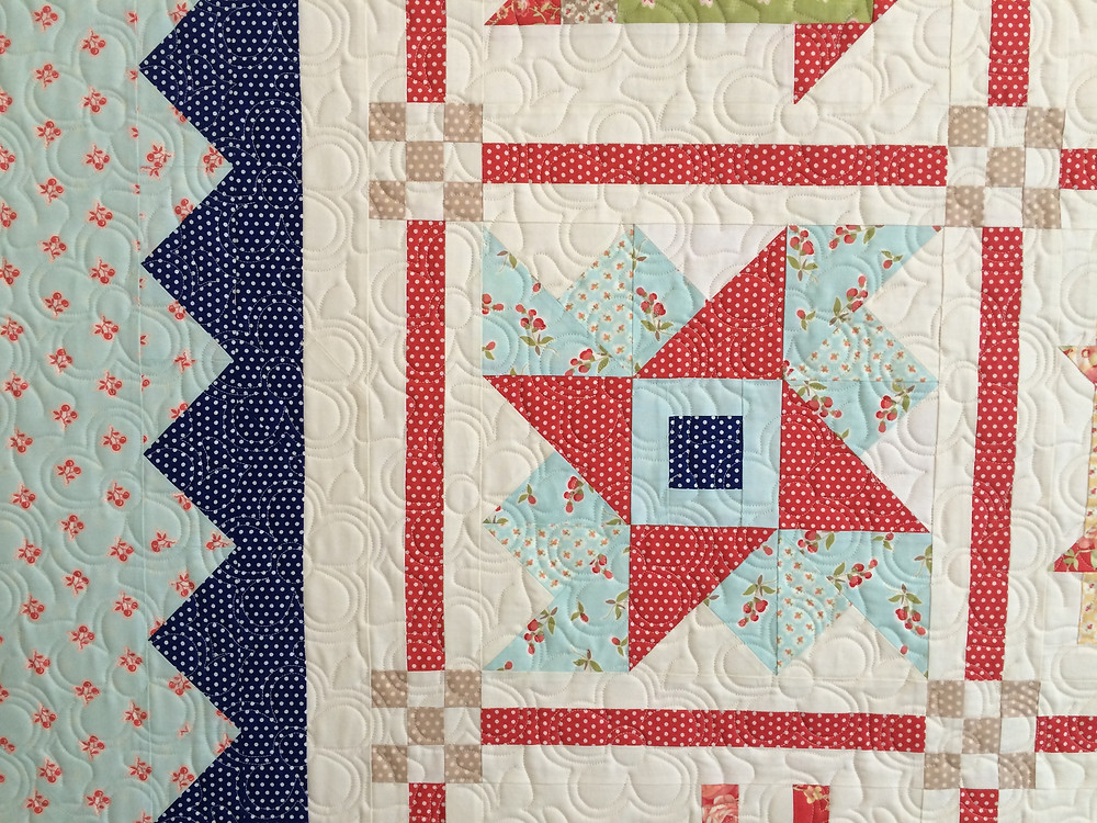closeup of block to sampler quilt in shades of blue