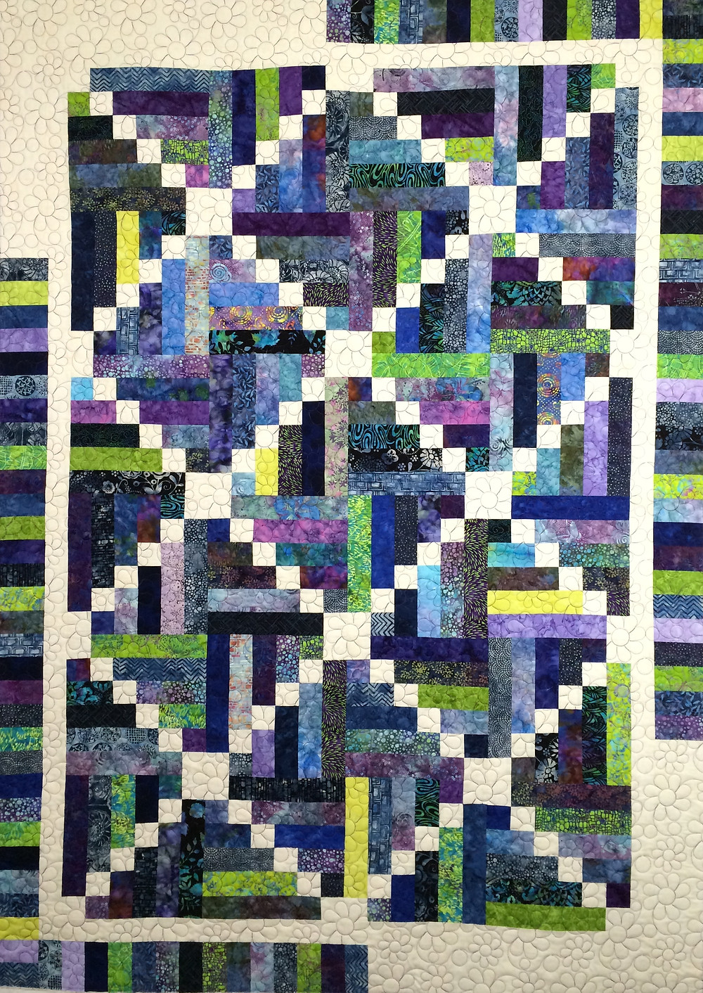 crossroads quilt in shades of blue and purple