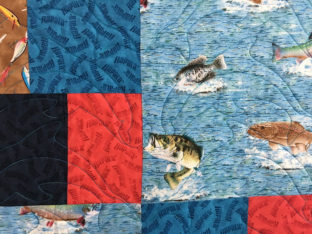 Fish quilting pattern on Just can't cut it Fishing Quilt by Joan Salesman