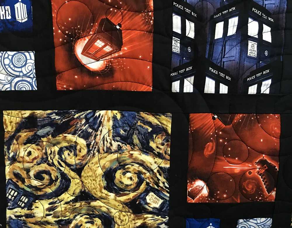closeup of Jamie Dr Who Quilt with black sashing