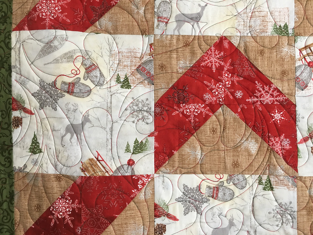 Feather Quilting pattern on Christmas quilt for parents by Sue Merritt