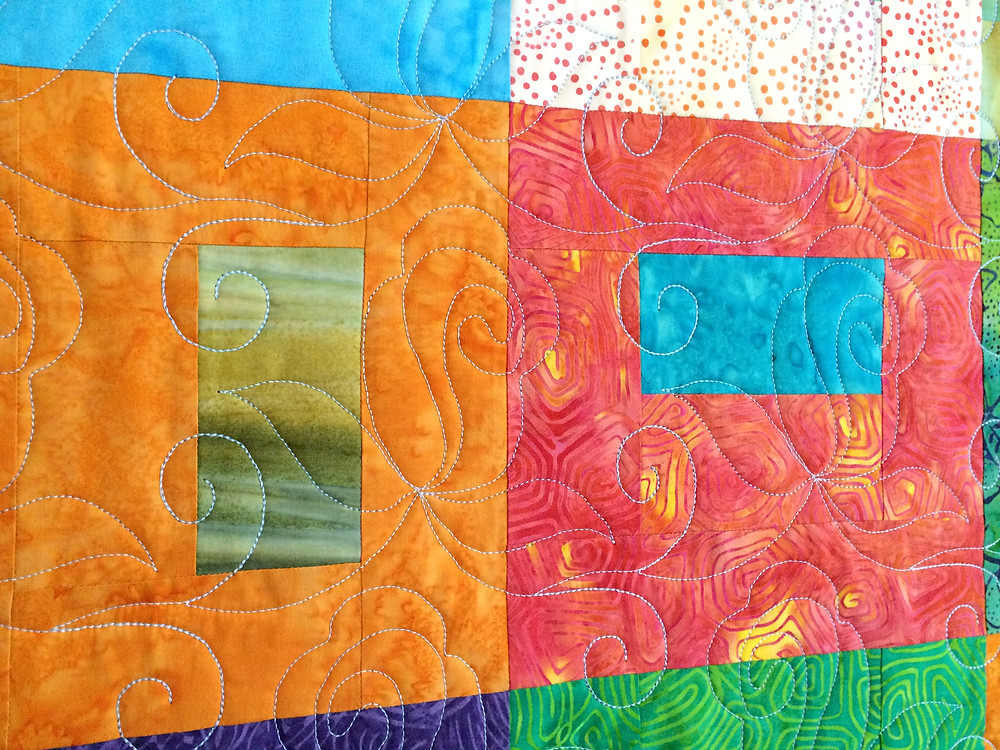 Rose bud quilting design on Lynn Capps contemporary qulit