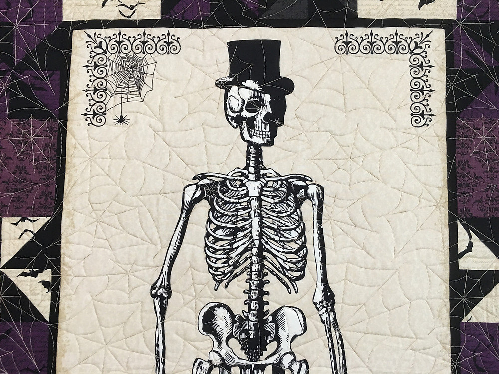 Closeup of Mr. Bones and the spider web quilting pattern