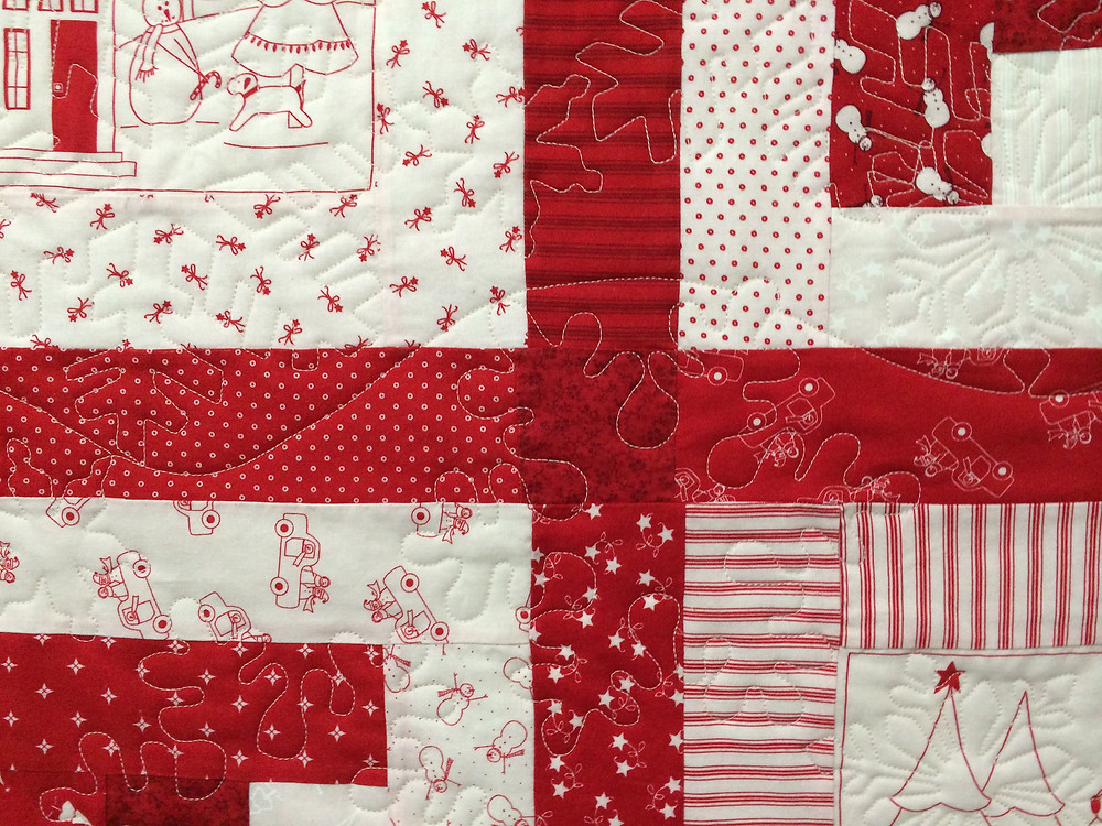 closeup of snowflakes on redwork snowman quilt