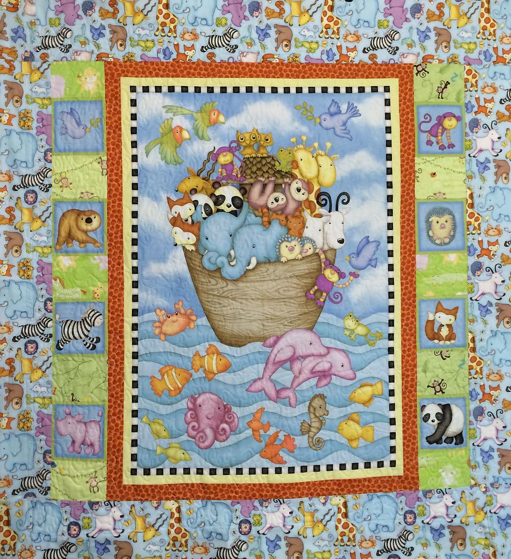 Noahs Ark Baby Quilt in soft pastels