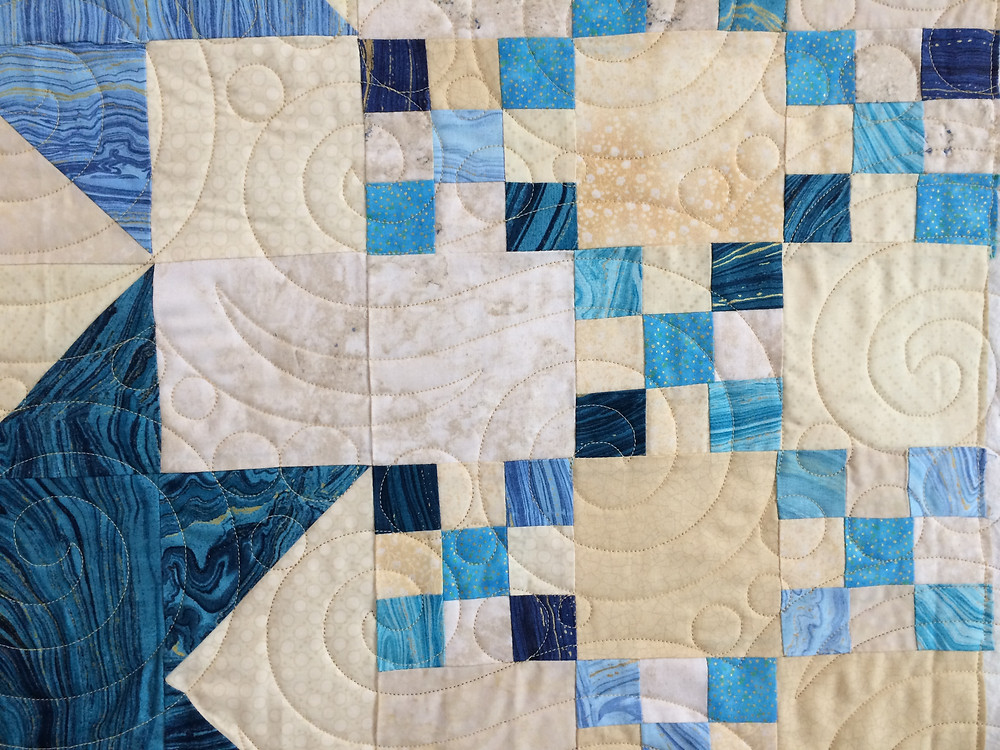 close up of Penny Wheat Sea and Sand Quilt