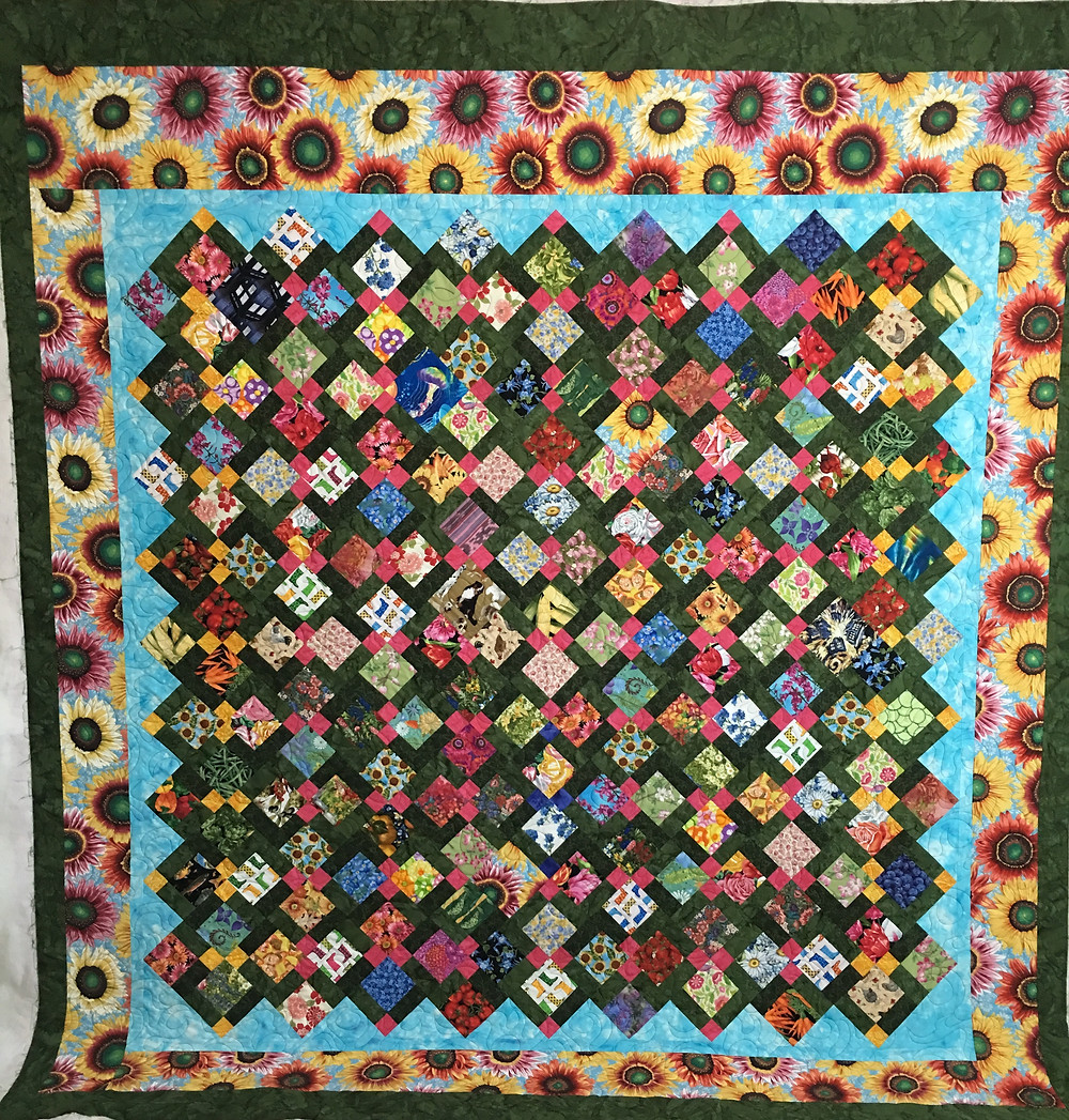 Disappearing 9 Patch quilt by Bridget Kauffman