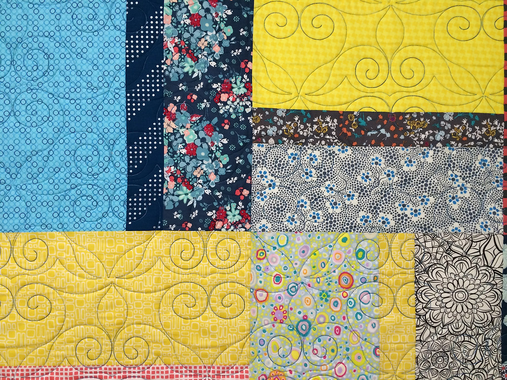 triple treat quilt with teal colored quilting