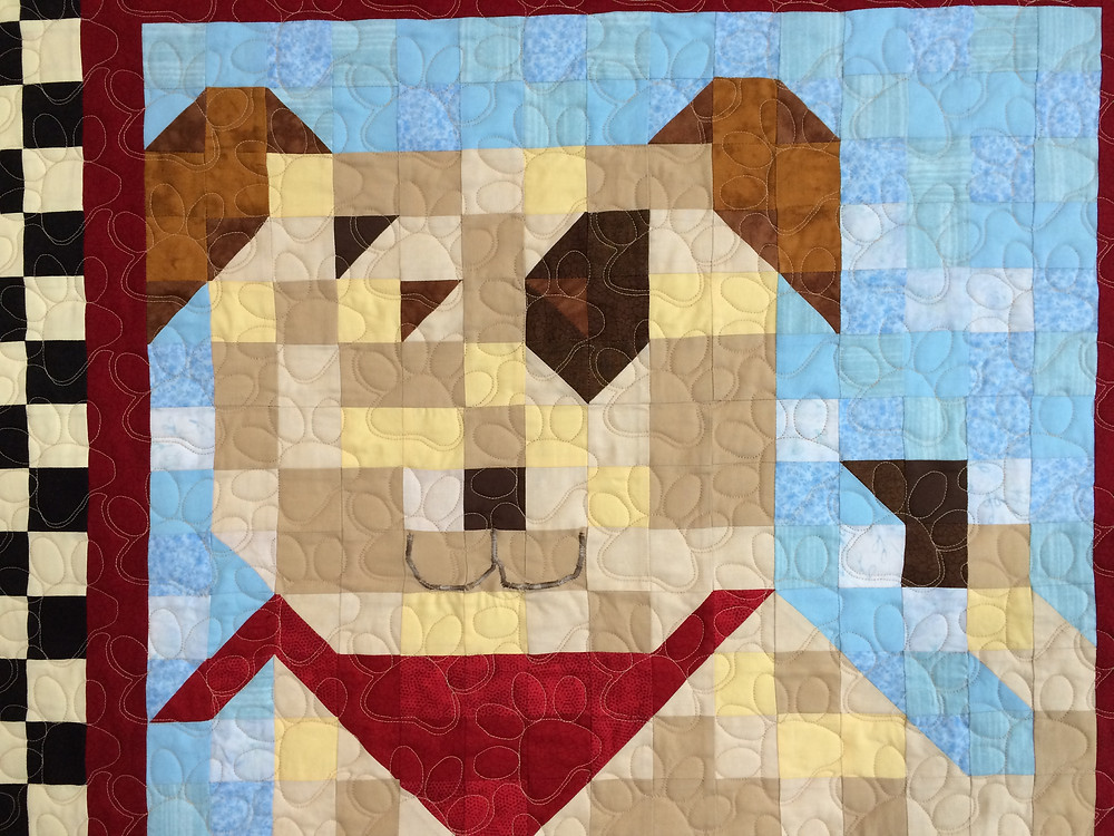 closeup of patchwork puppy with red bandana