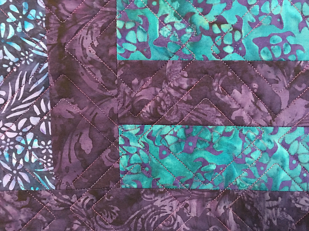 Geometric Quilting Pattern on Purple and Green Batiks Quilt by Nancy Nesbaum