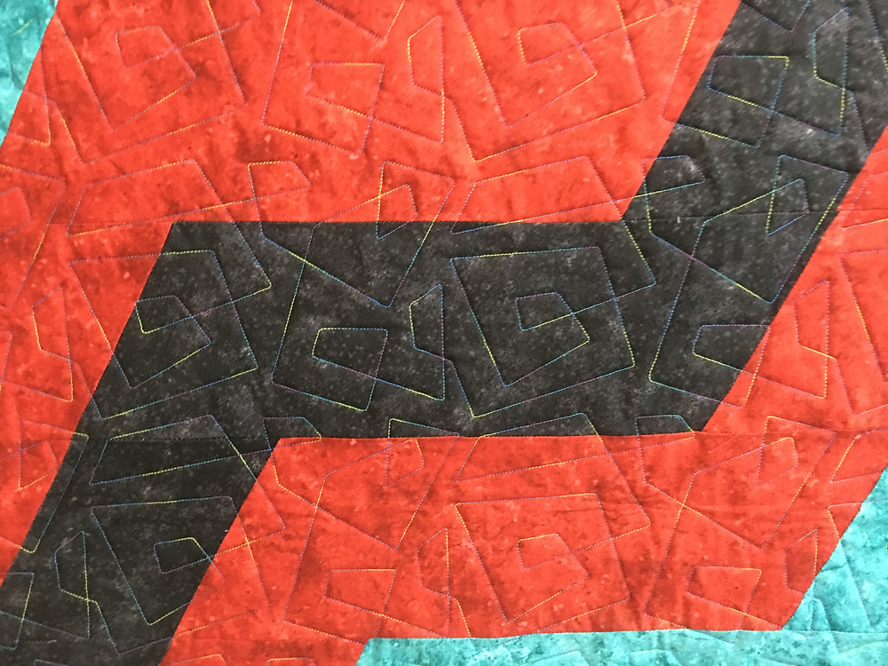 Geometric quilting pattern on zig zag quilt by Sally Krebs