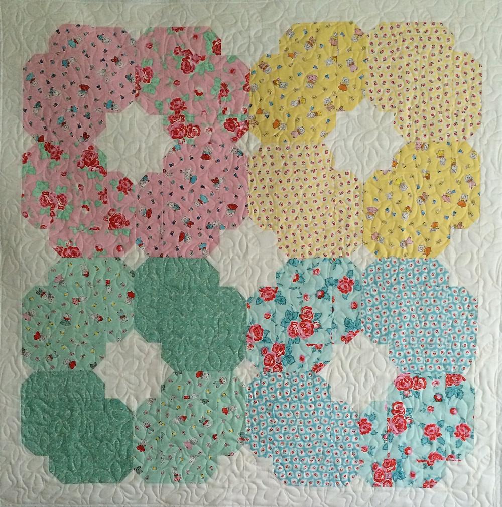 Milk Flower Sugar Baby Quilt in shades of soft pastels