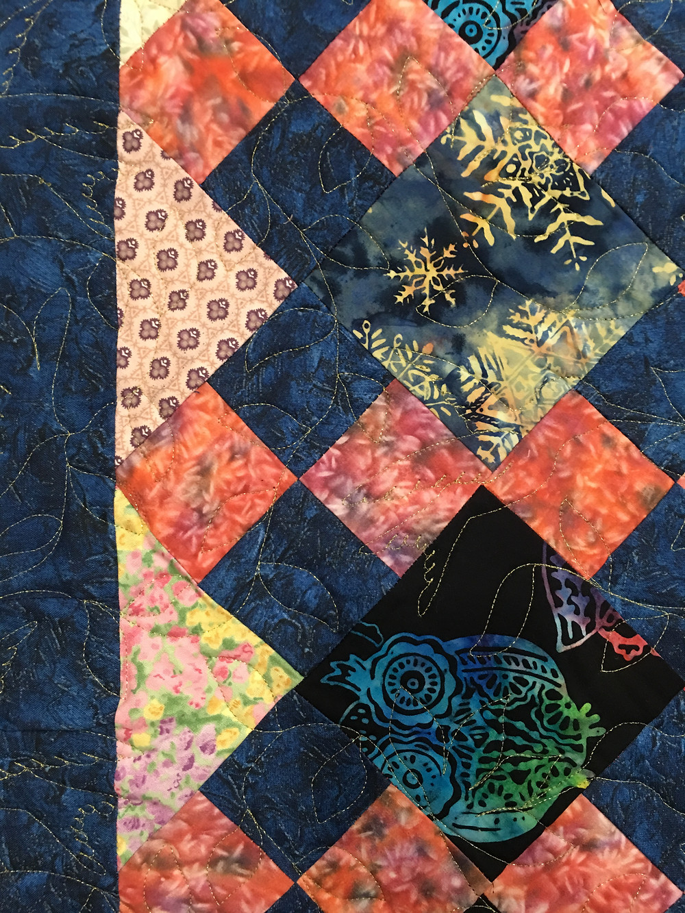 Closup of JoAnn Four Square Scrappy Quilt