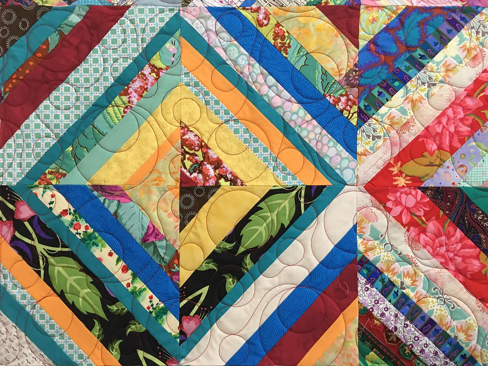 close up of Jean Colorful Scrappy Quilt