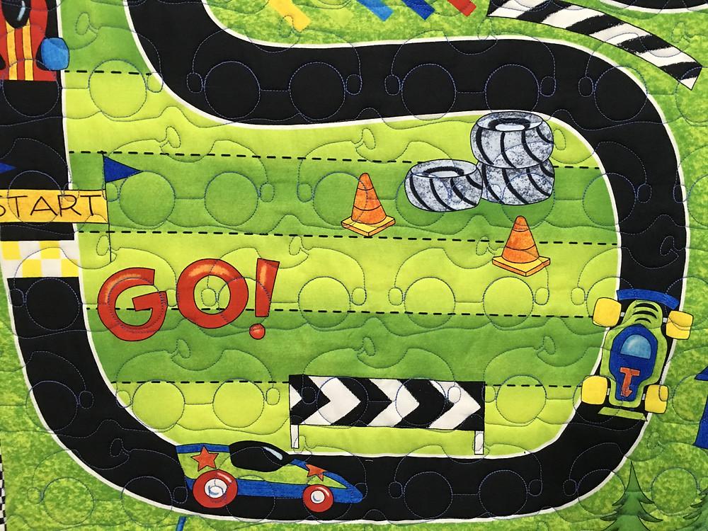 Closeup of Jeri Couthern Racing Car Quilt