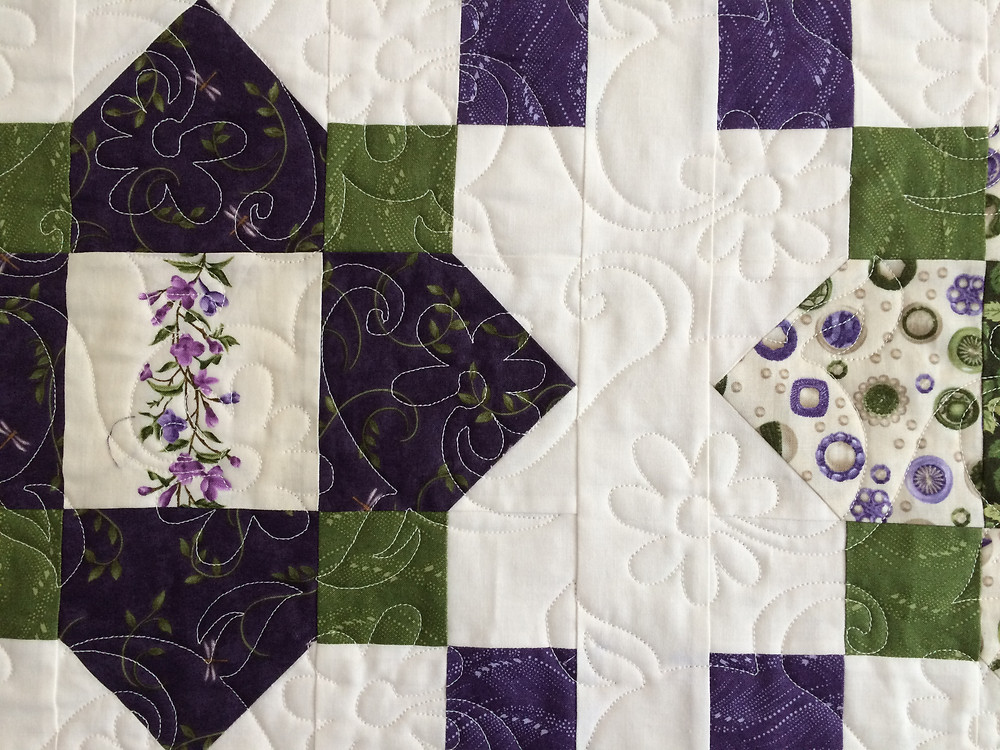 closeup of Mary Derryberry Quatrefoil Missouri Star Quilt