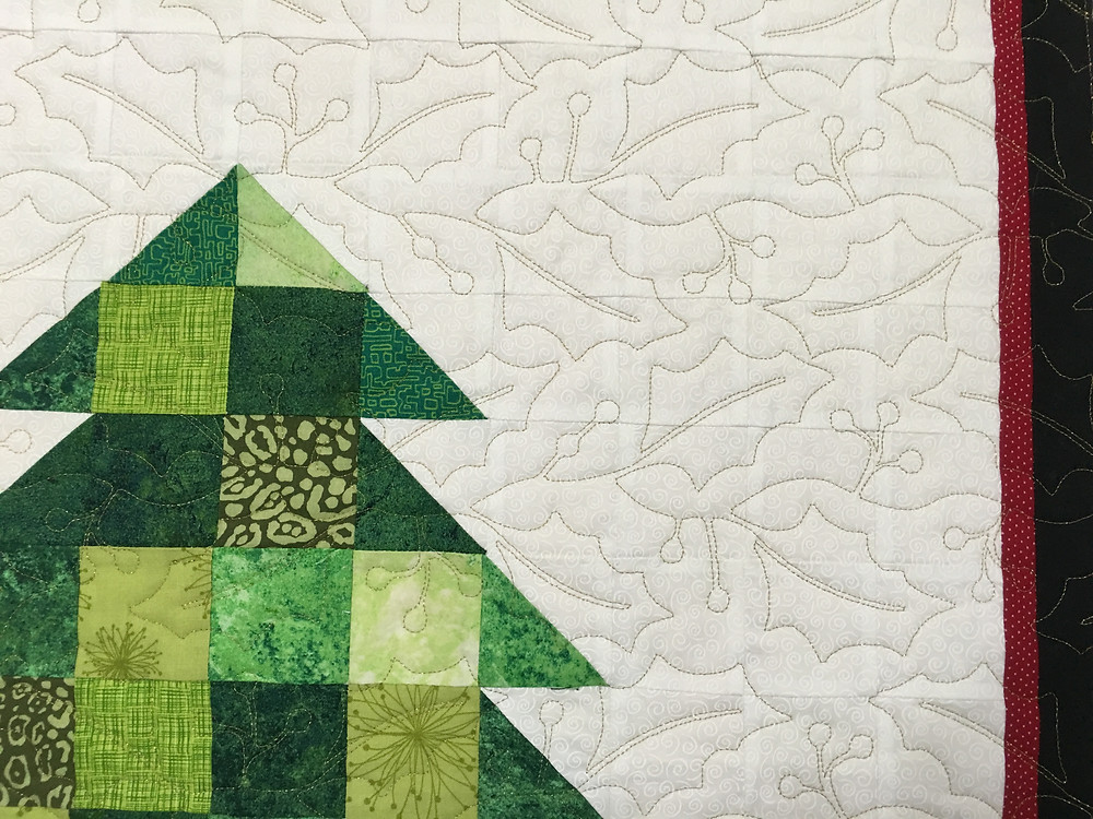 closeup of quilting patters Holly Leaves on Laura Wetzel's Quilt