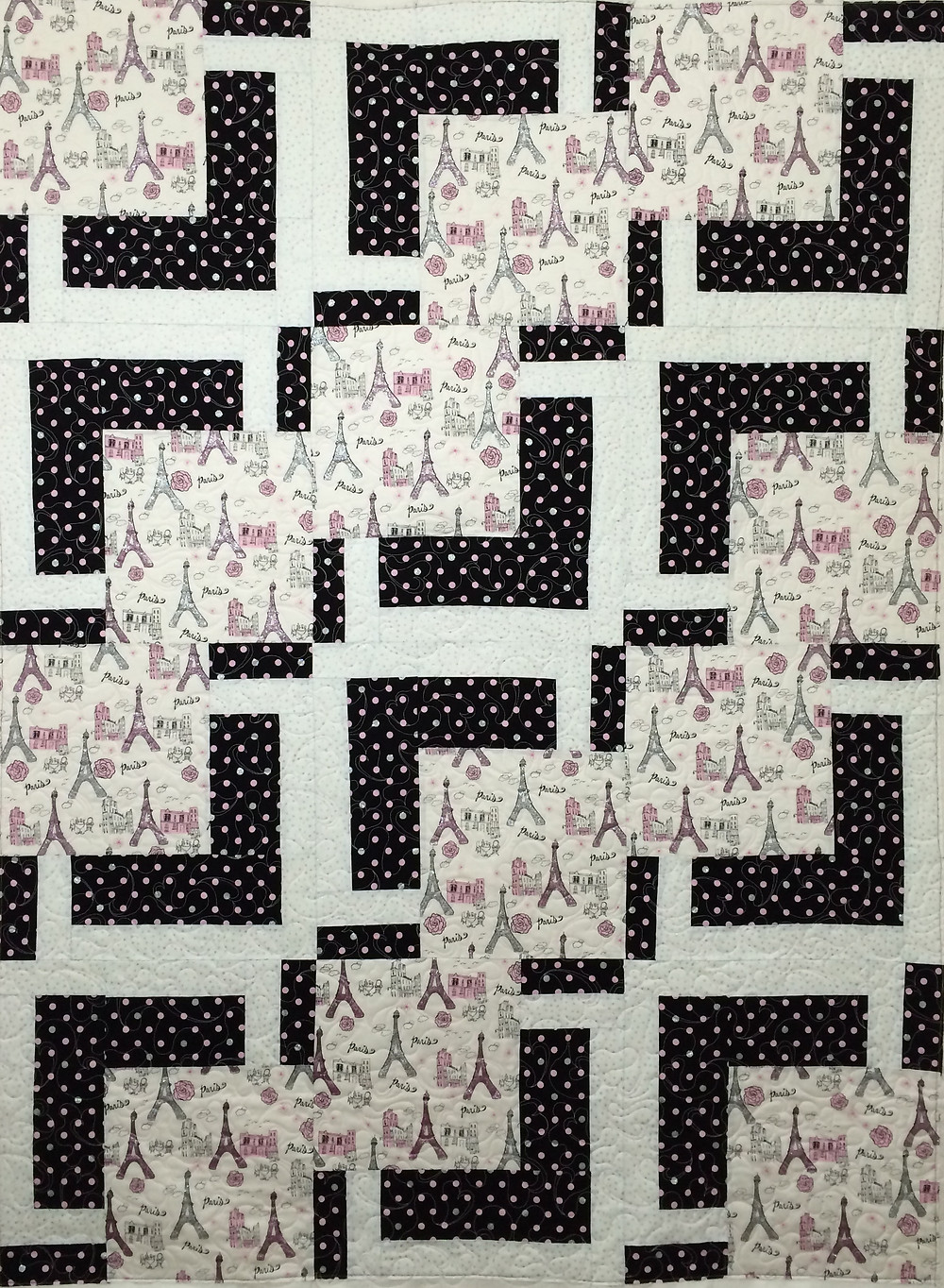 little girl Paris quilt with black and white polka dot fabric