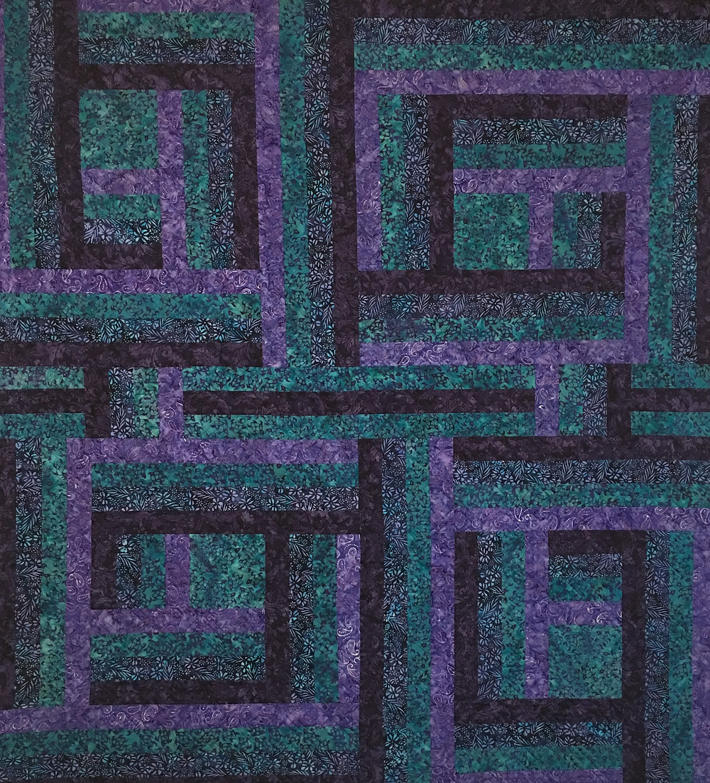 Purple and Green Batiks Quilt by Nancy Nesbaum