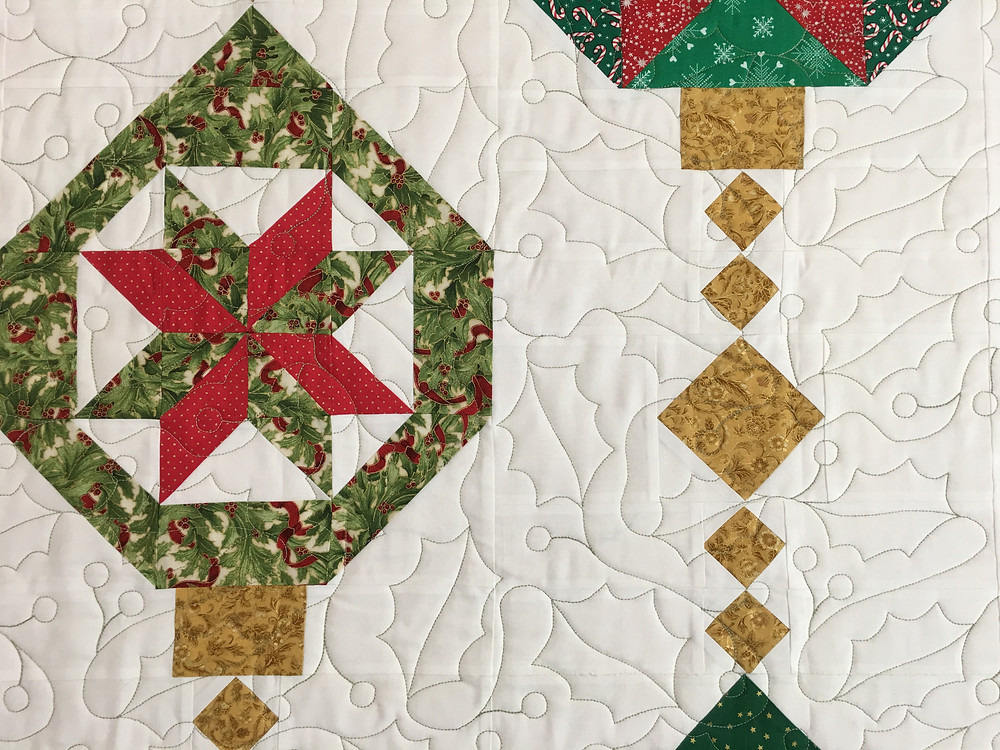 Holly Leaves quilting pattern on Christmas Ornaments quilt by Joan Salesman