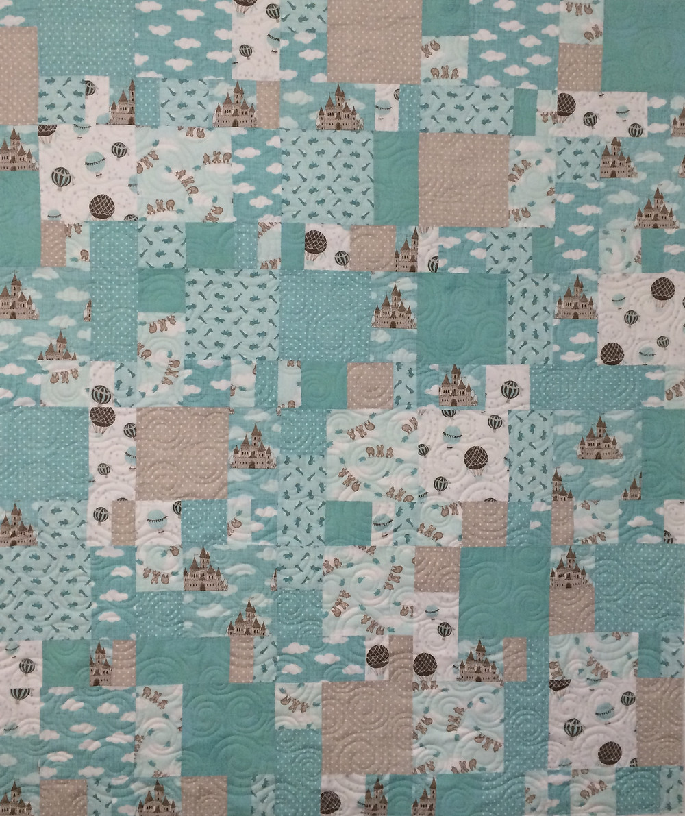 baby quilt in shades of aqua and tan