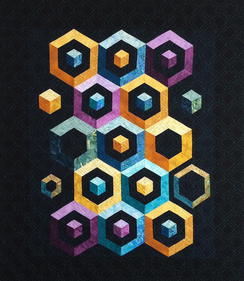 geometric blocks on black quilt