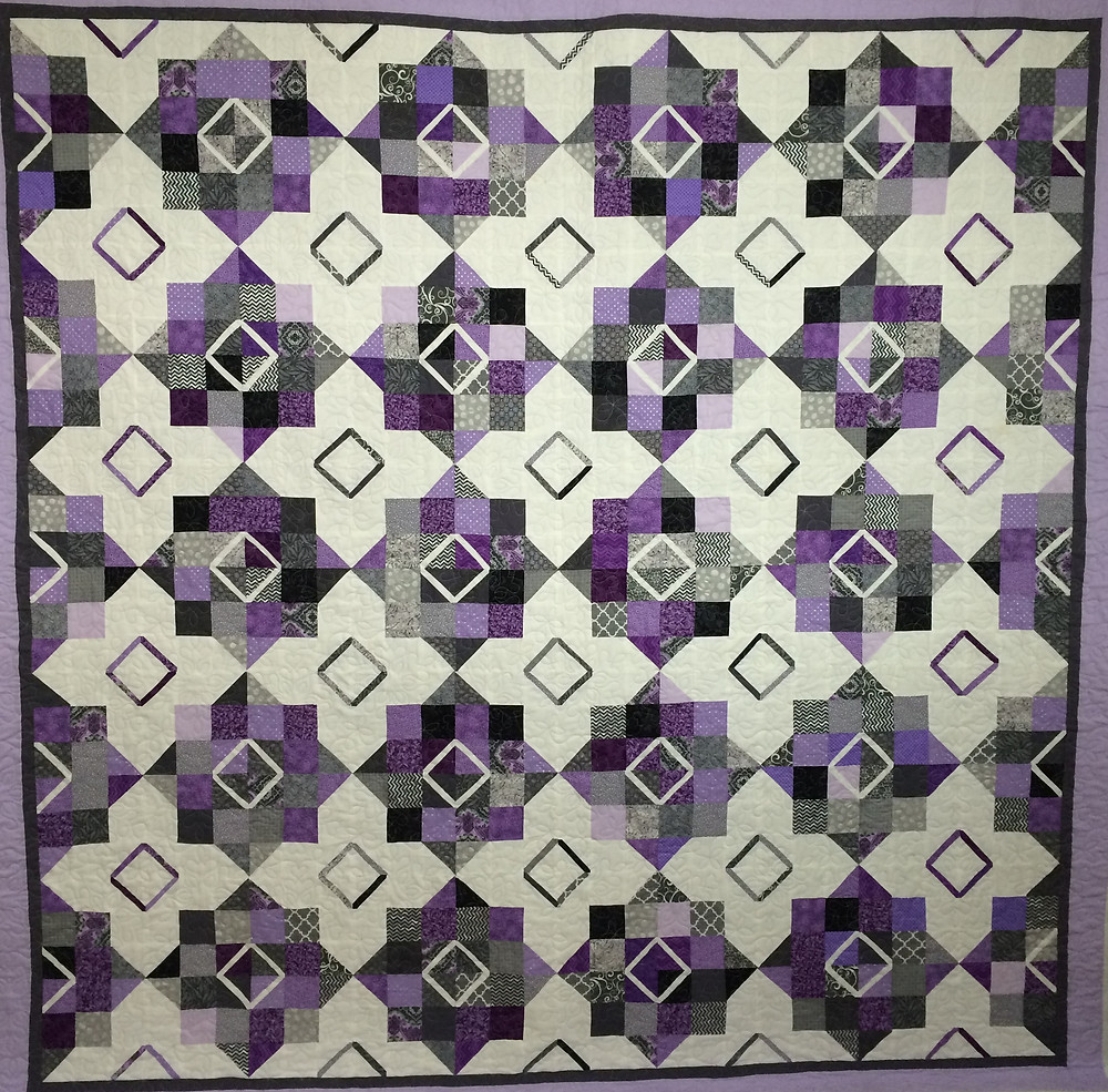 floating blocks in purples grays and white