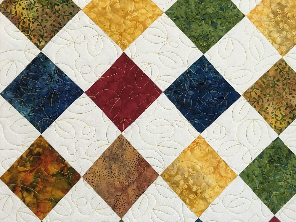 Leaves quilting design on Diamond Patch Quilt by Roxane Darnell