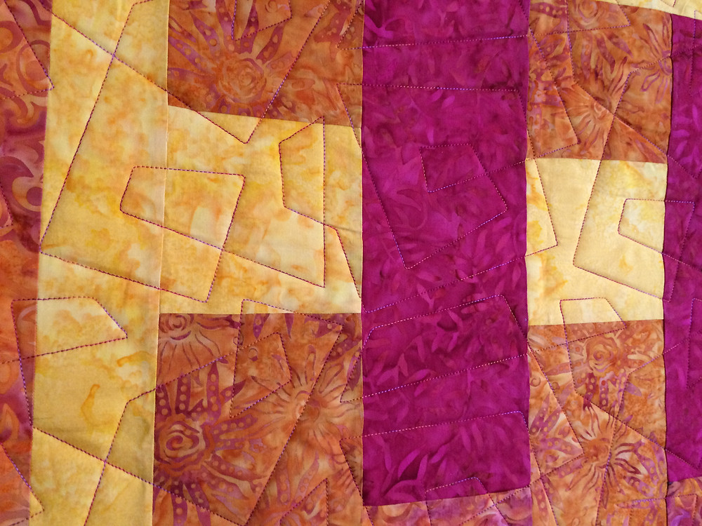 Nancy Thornton closeup of hot pink yellow and orange quilt