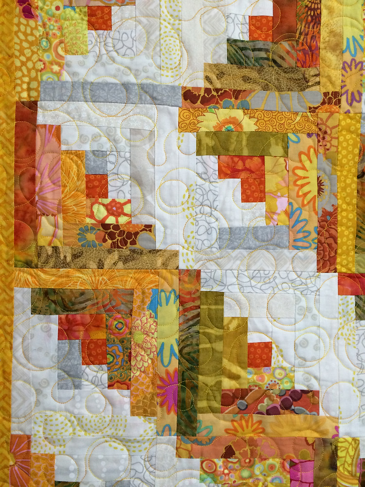 closeup of Sue Antle Yellow and White Log Cabin