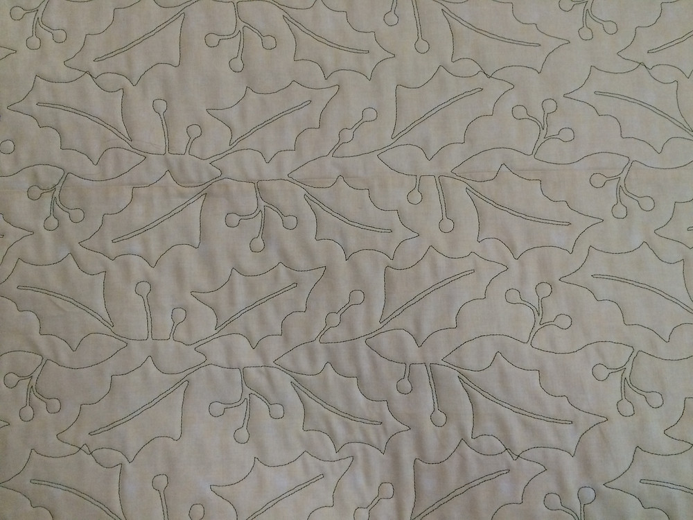 backing of Nancy Thornton's Christmas in soft reds and greens quilt