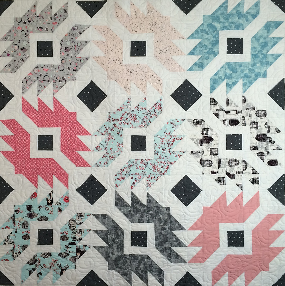 Codi Mangrum Wonderland Quilt in shades of gray and pink.