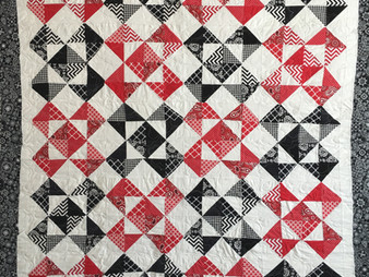 Jefferson Sutton Red and Black Half Square Triangles Quilt