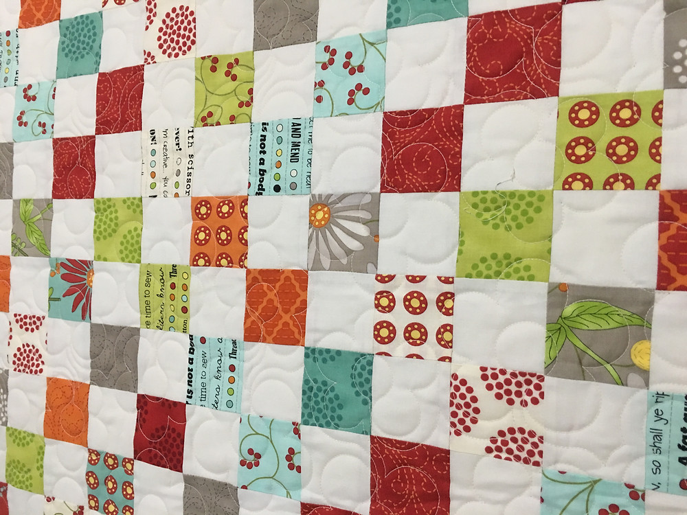 Flowers Quilting Pattern on Postage Stamp Quilt by Karen Hollensbe