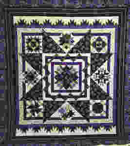 Stars Among the Violets Quilt by Pam OKane