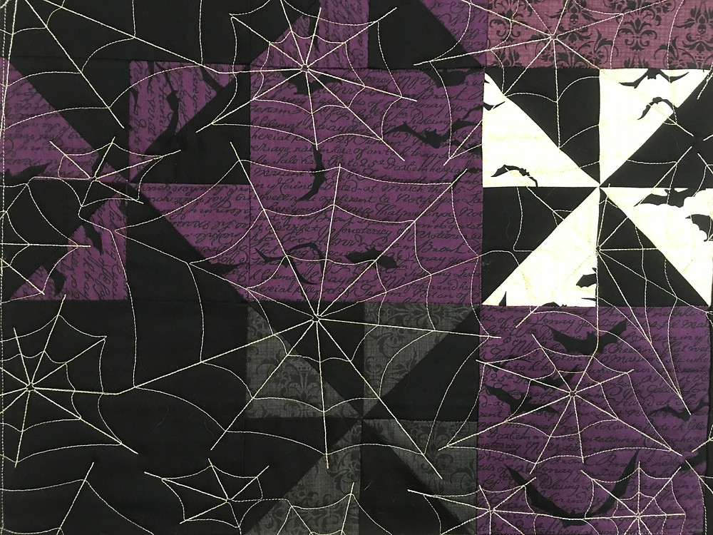 Another closeup of the spider web quilting pattern on Julianna's quilt