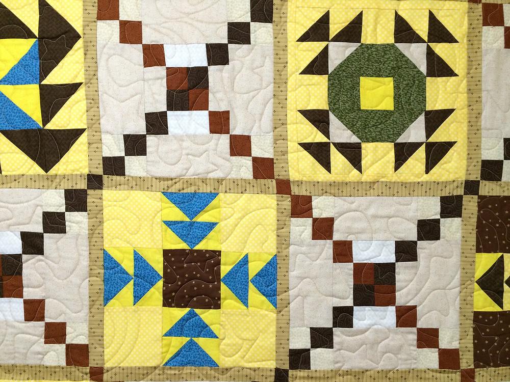 Meander Quilting Pattern on Sampler Quilt by Marietta Matheaus