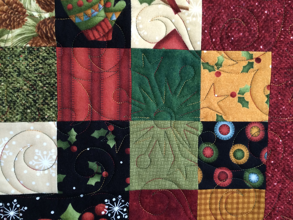 Another close up of Leslie St. Onge Christmas Quilt in Flannel