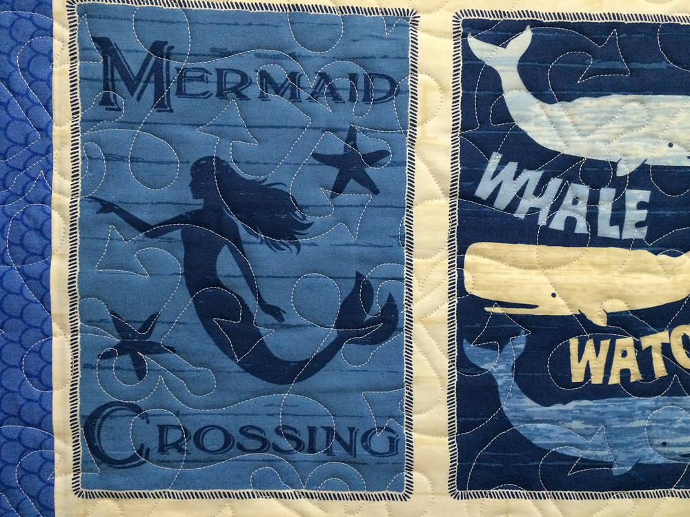 Close up of Little Mermaid beach quilt