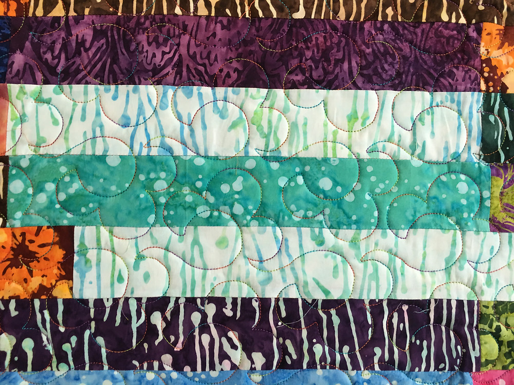 curves quilting pattern on jelly roll quilt by Myrt Gross
