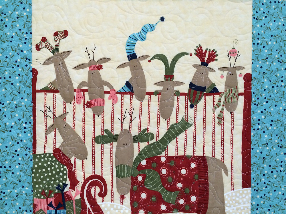 close up of Nancy Thornton Reindeer and Log Cabin Blocks Quilt