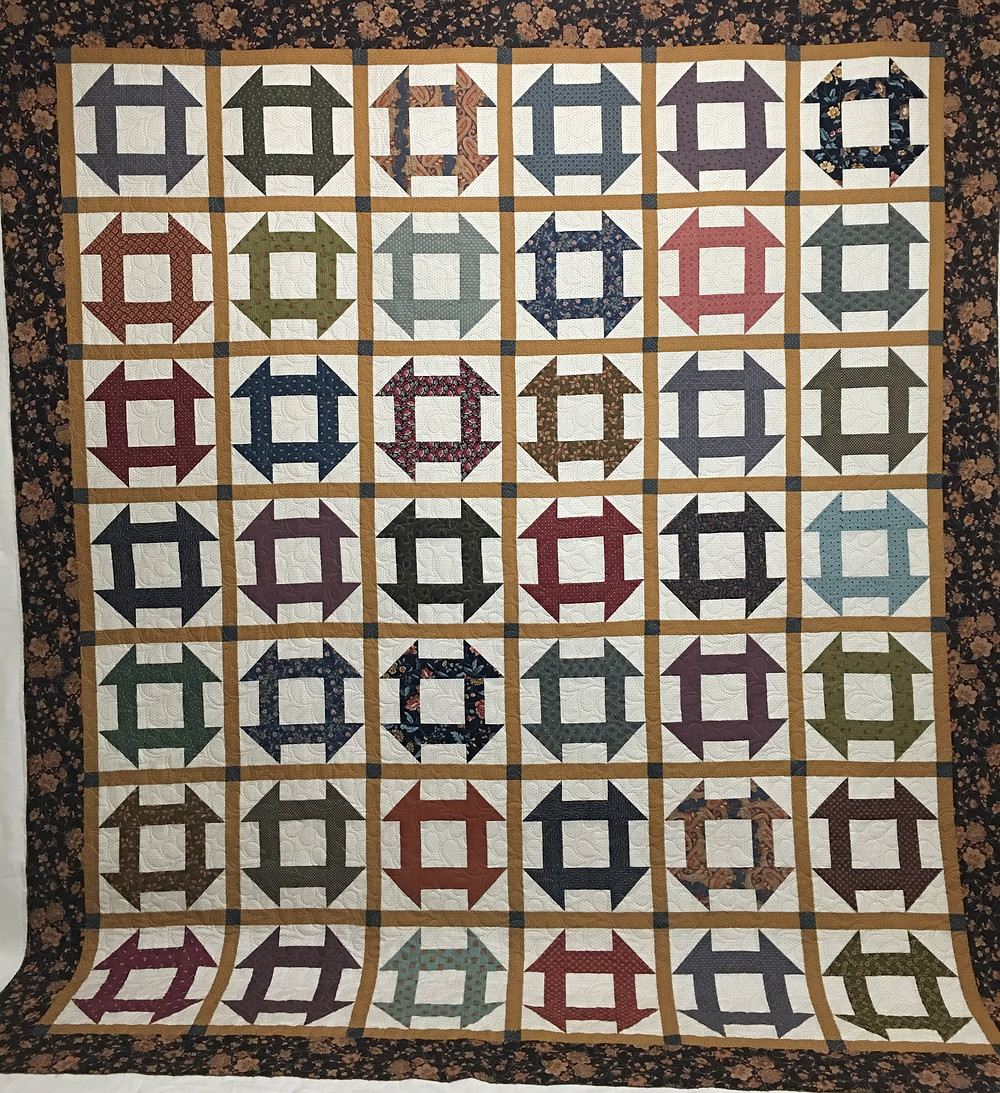 Churn Dash quilt by Penny Gregory