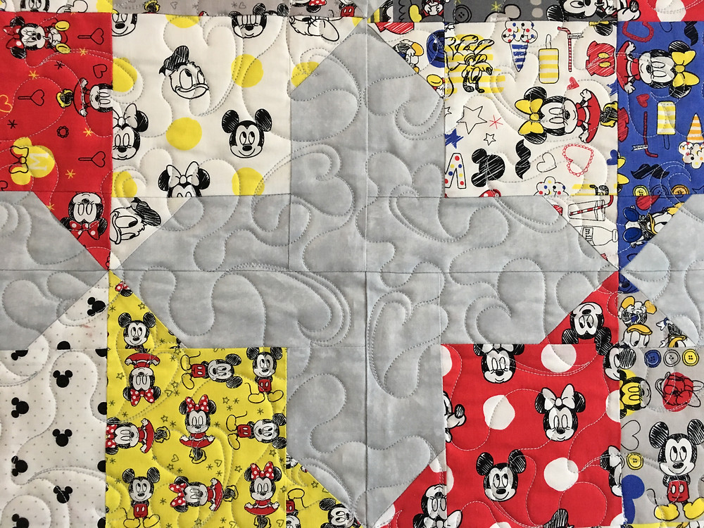 Hearts quilting pattern on Mickey Mouse prints in Double Square Star Quilt