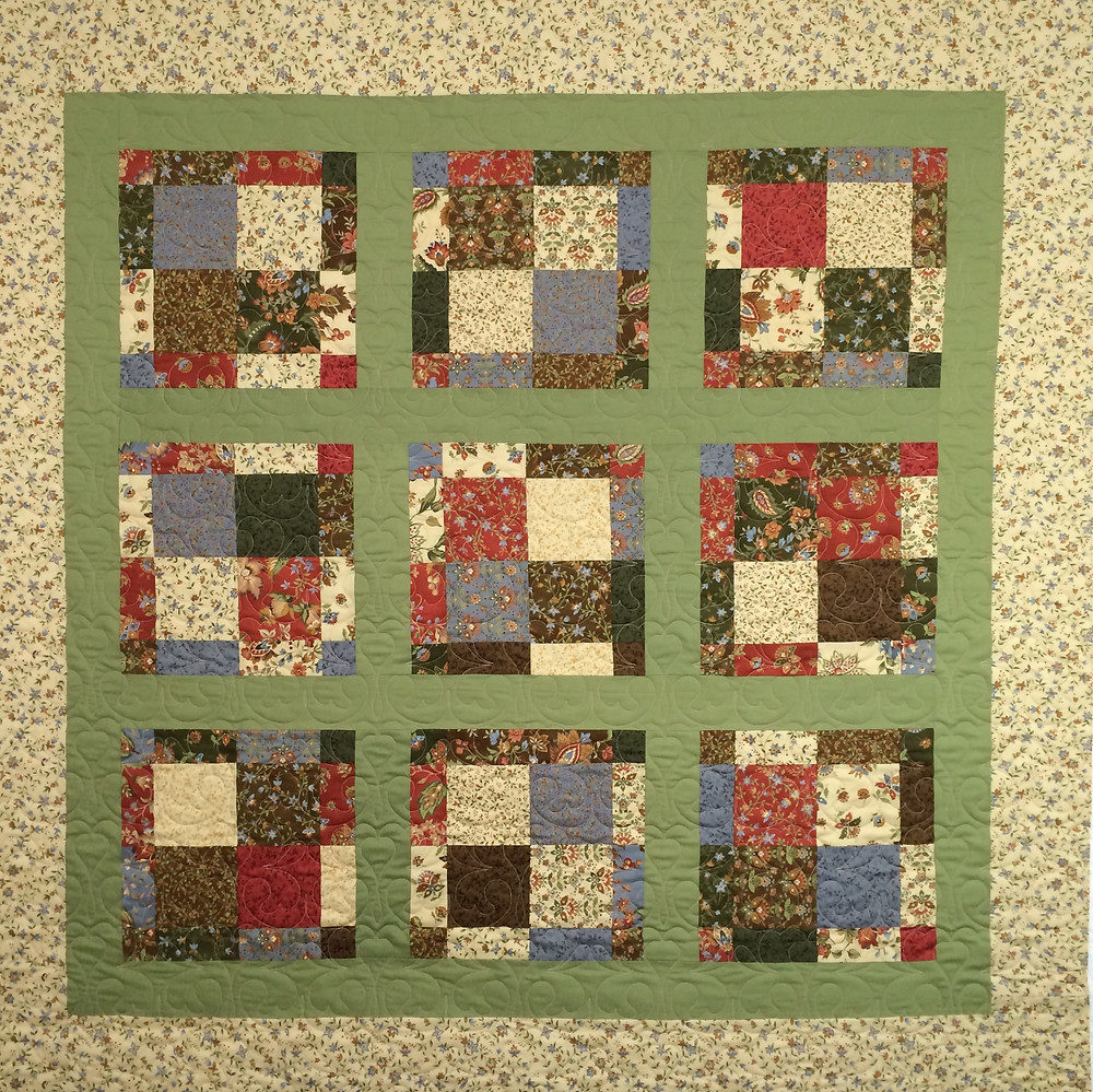 scrappy quilt original design in multiple prints