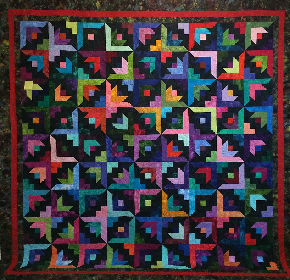 jewel tone batik quilt flower design