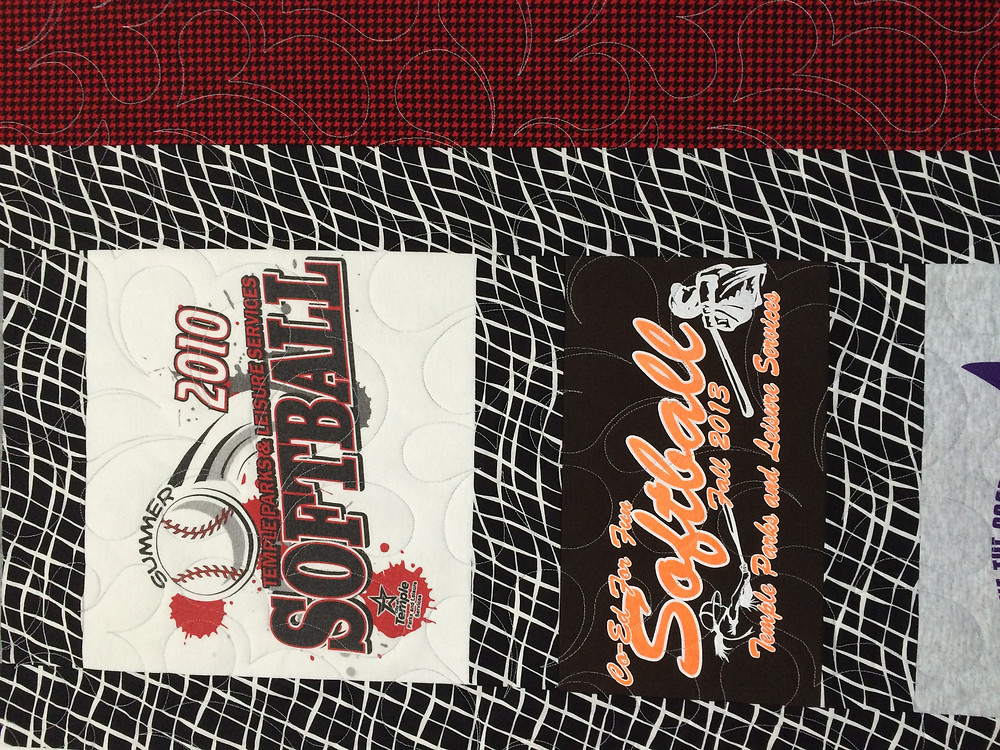 close up of feathers designs on softball tshirt quilt