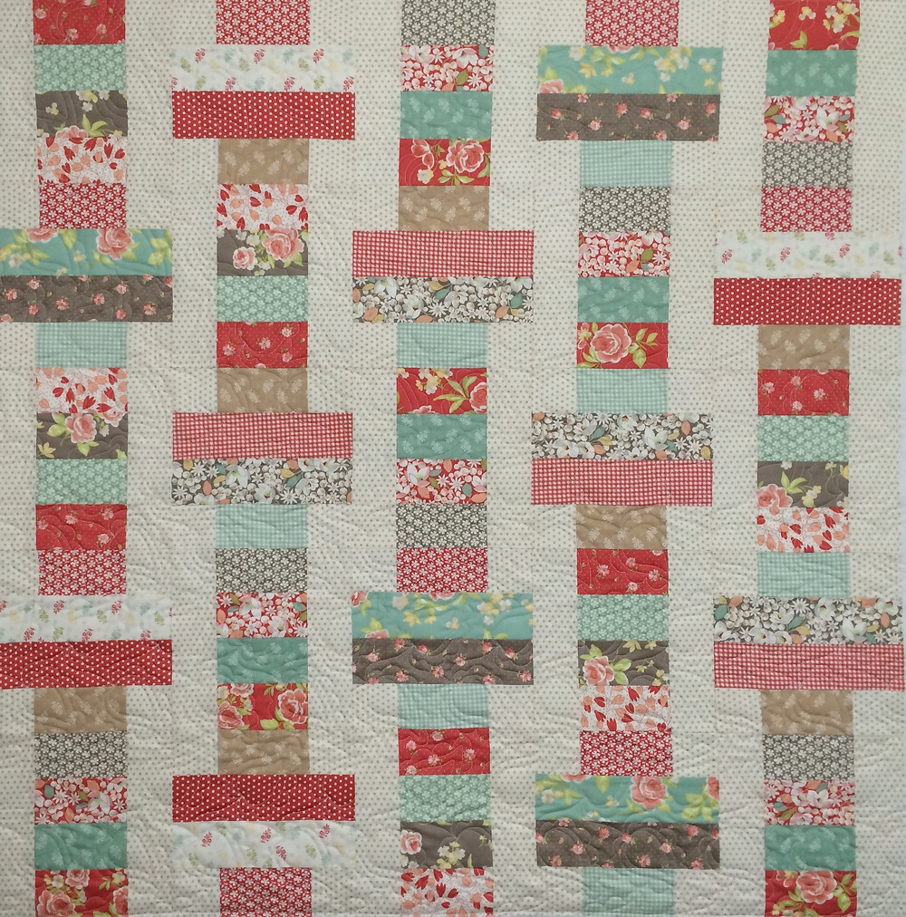 Cheryl Jelly Roll Slice Quilt