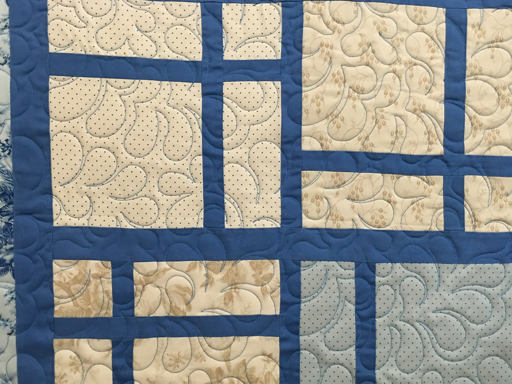 Closeup of Peggy Krebs Cool Blue Layer Cake Quilt