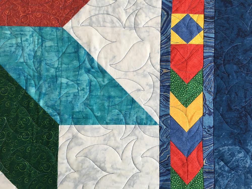 Swirls Quilting Pattern on Lemoyne Star Quilt by Peggy Krebs