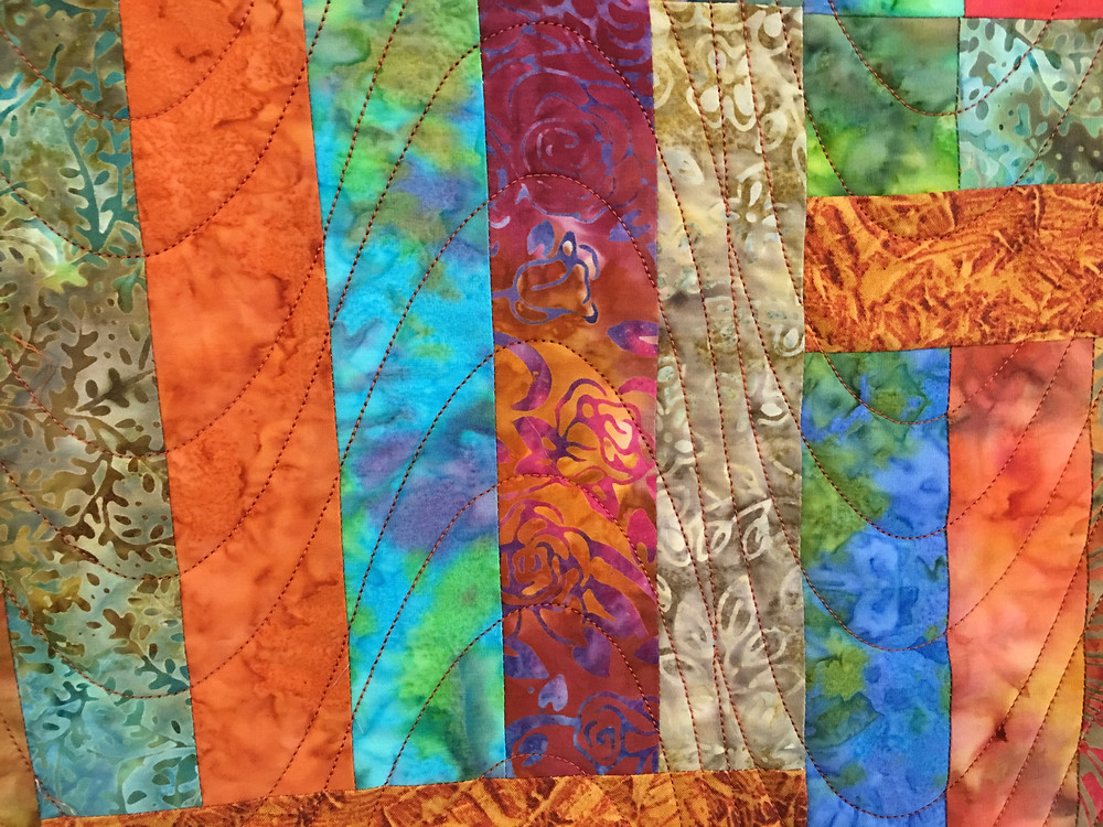Swirls Quilting Pattern on Squares and Rectangles in Batiks Quilt by Valarie Sherriff